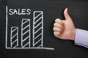 Sales Growth on a blackboard with Thumbs Up