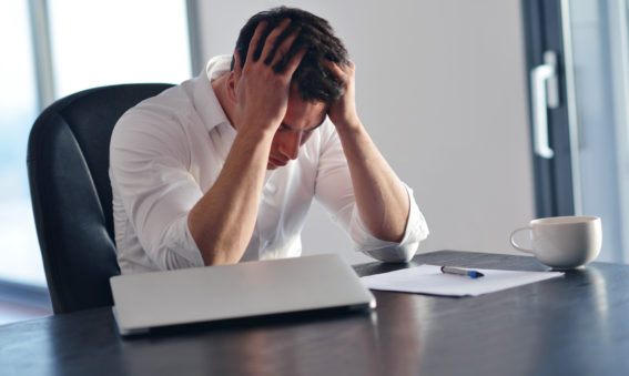 frustrated-man-at-desk-worker-stress-productivity
